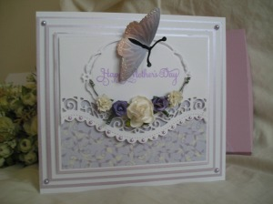 Made using Spellbinders Curved Borders 2, Opulent Ovals & Joy Crafts Butterfly.